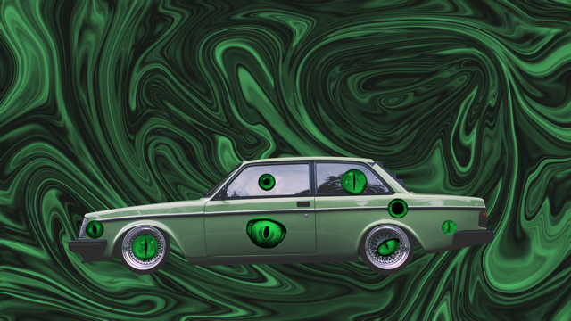 green car with green eyes on it