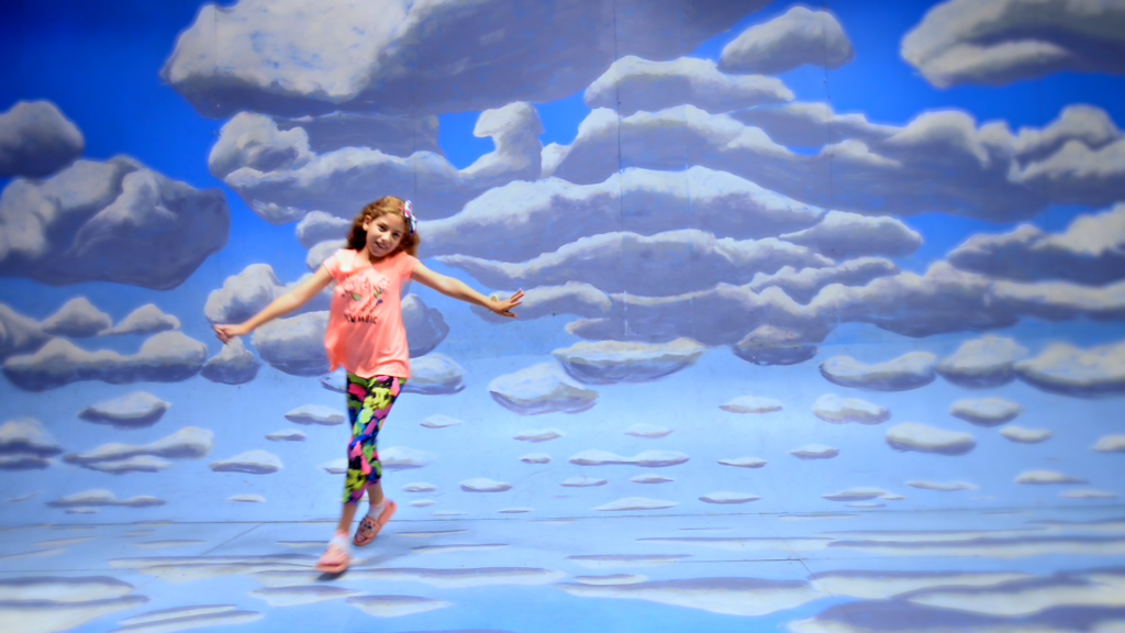 girl dancing against cloud background