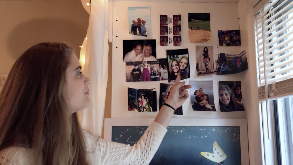 girl showing pictures of her family