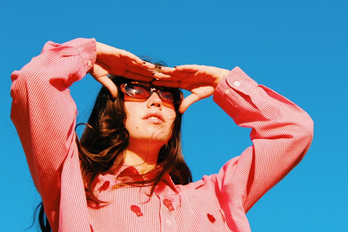 girl with sunglasses and sky background